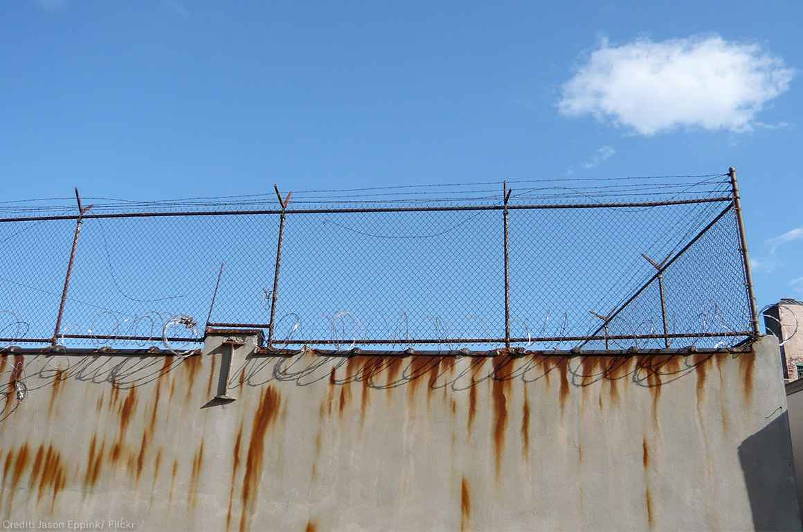 Barbed wire fence outside prison